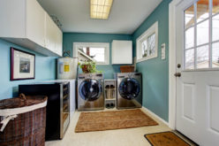 Light Blue Laundry Room With Modern Laundry Appliances