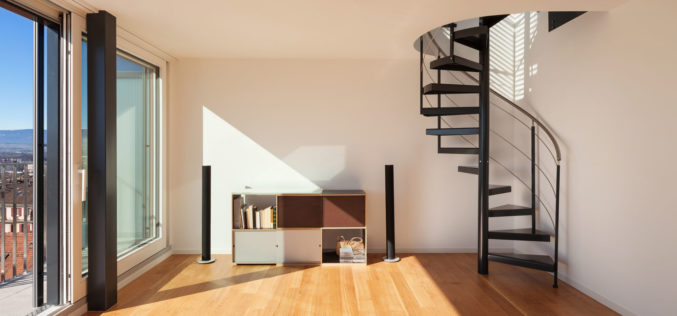 Interior View, Open Space of a Duplex with Spiral Staircase