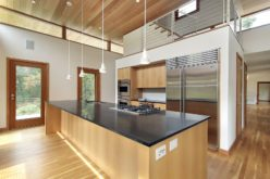 Kitchen in Ultra Modern Home with Sleek Granite Island