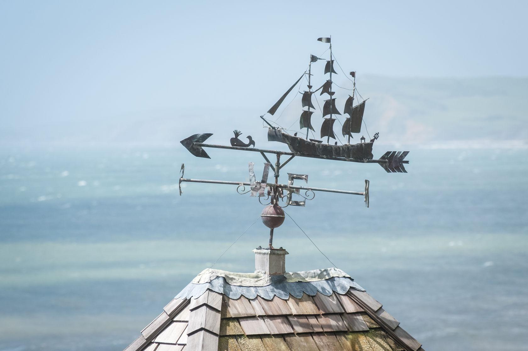 rooftop weathervane overlooking coastline