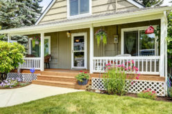 Cozy Inviting Porch with White Railings and Brown Wooden Floor