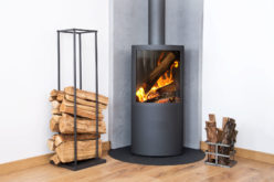 Modern Wood Burning Stove Tucked in Room Corner