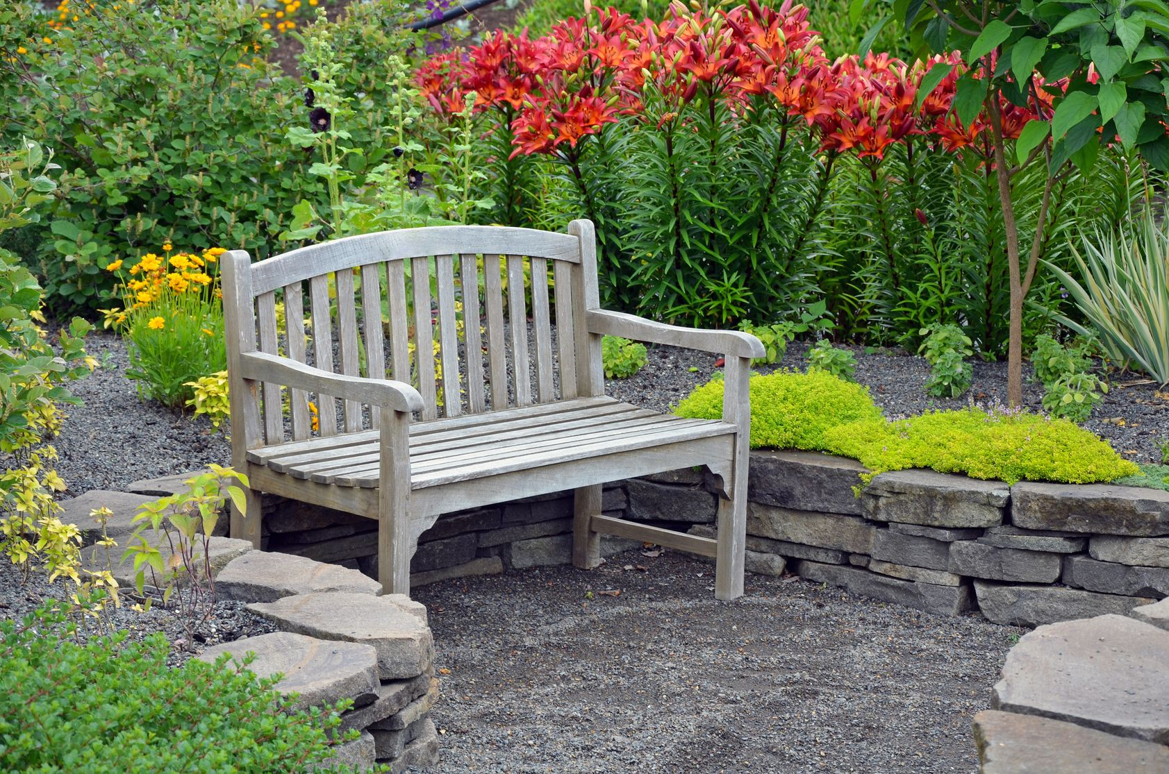 garden bench in lily flowers