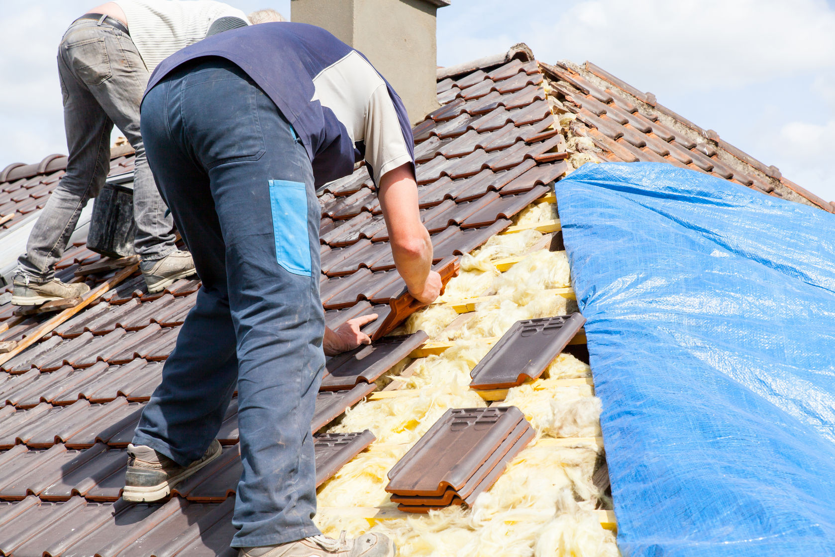 roofing contractors laying tile